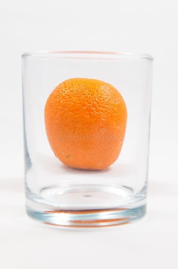 Orange in glass royalty free stock photo