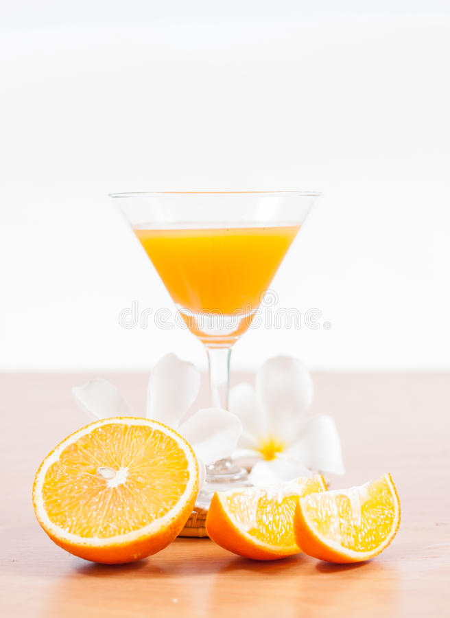 Orange and glass with juice.  royalty free stock image