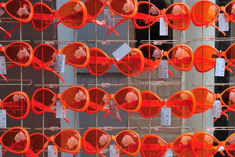 Orange glasses. In a store in Amsterdam stock photos