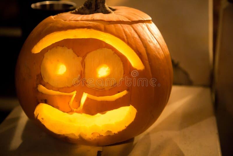 Orange glowing halloween carved pumpkin stock photography