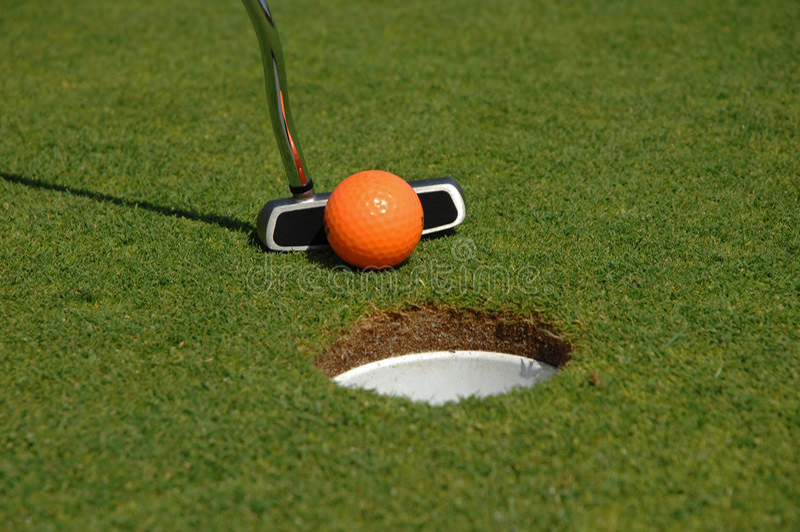 Orange golf ball royalty free stock photography