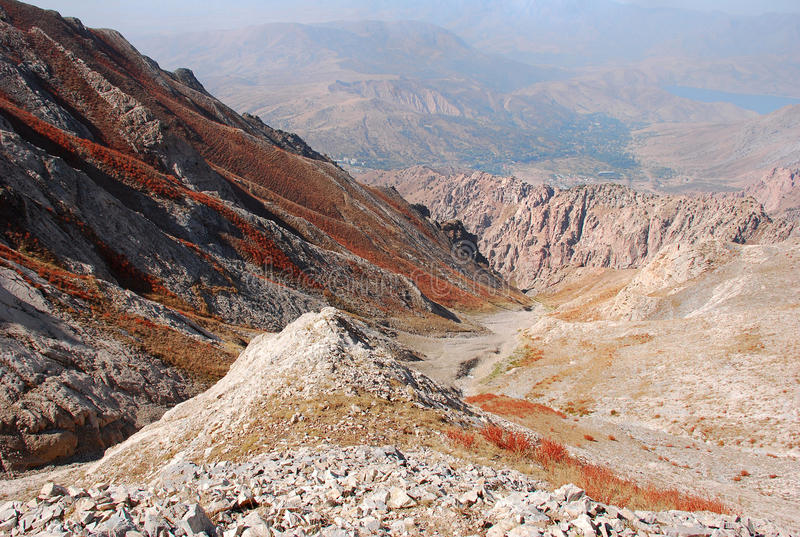 Orange gorge on the background of the panorama of mountains of Tien Shan stock photography