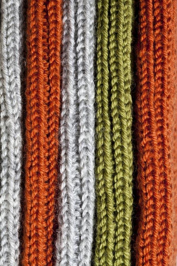 Orange, grön och grå ull stucken textur arkivfoton