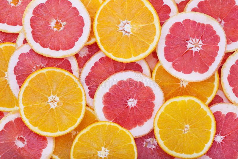 Orange and grapefruit rings as background royalty free stock image