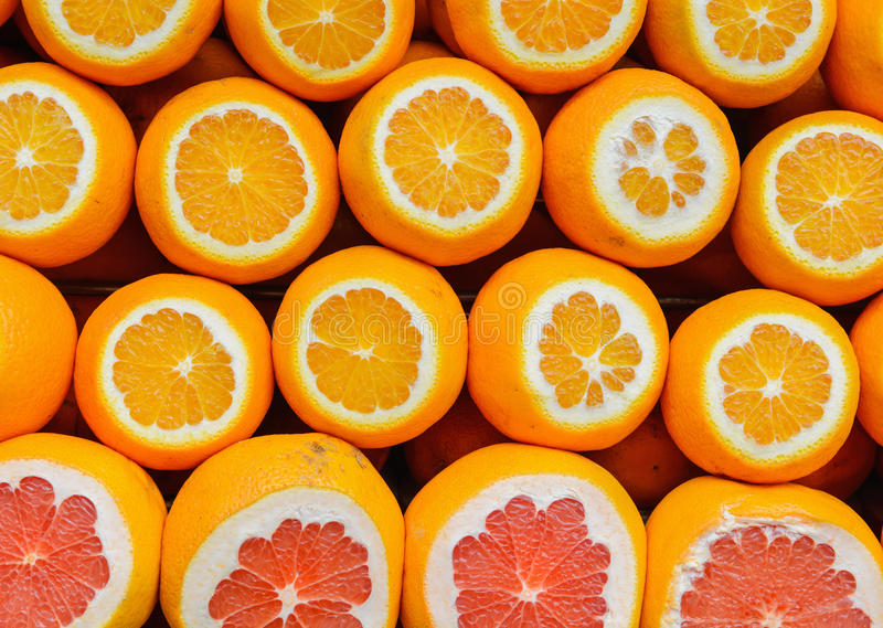 Orange and grapefruit rings as background royalty free stock images