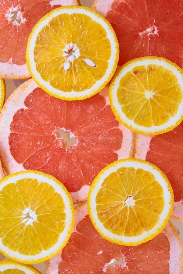Orange and grapefruit rings background royalty free stock photos