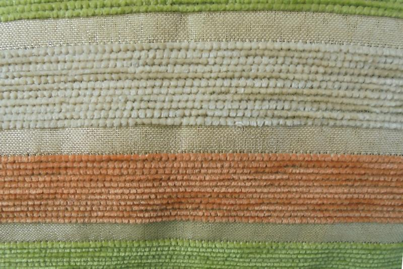 Orange green beige stripes on the tapestry. fabric texture. Orange green beige transverse stripes on the tapestry. fabric texture stock image