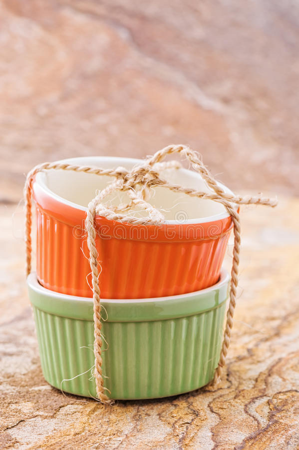 Orange and green cocotte royalty free stock image