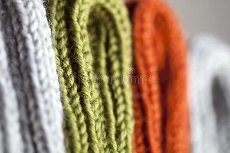 Orange, green and grey wool knitted texture. Background stock photos