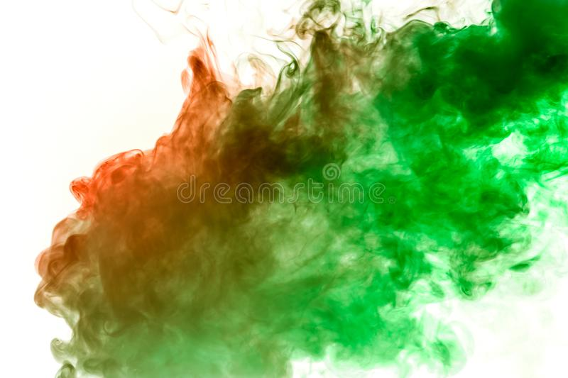 Orange-green smoke swirls on a white background depicting a beautiful pattern, decorative ornaments. Color transition by substance royalty free illustration