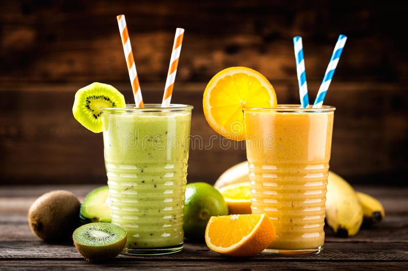 Orange and green smoothies with exotic fruits. Healthy eating, superfood royalty free stock photos