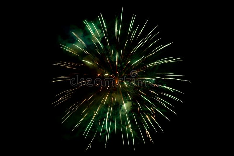Orange Green Sparkling Fireworks Background on Night Scene royalty free stock photography