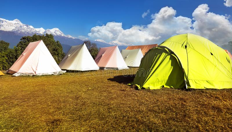 Orange and green tent on the Hill on a sunny day.in australian base camp. Orange and green tent on the Hill on a sunny day. in australian base camp Nepal royalty free stock photography