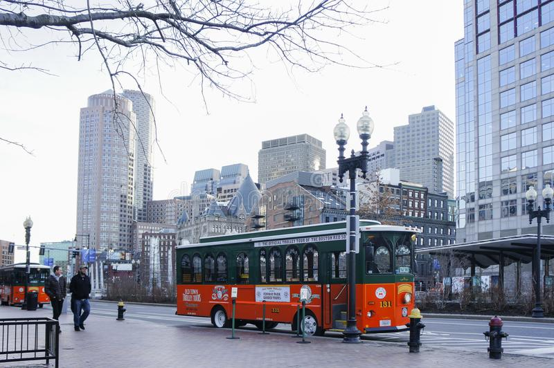 Orange and green Trolley Tour Bus royalty free stock images