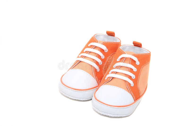 orange gymnastikskor royaltyfria bilder