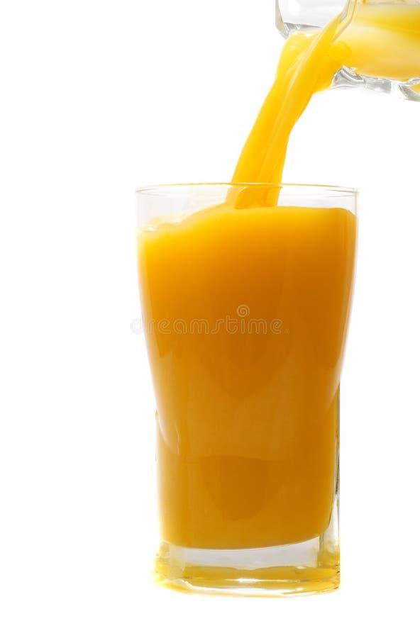 orange hälla för ny fruktsaft fotografering för bildbyråer