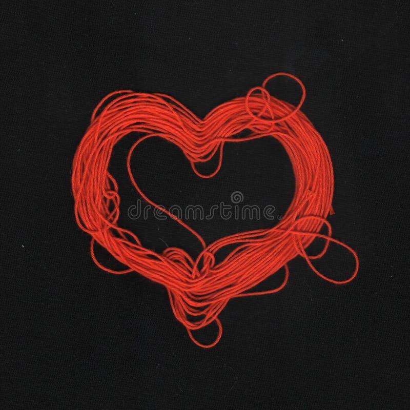 Orange härd som göras av tråden på svart backgroung royaltyfri fotografi