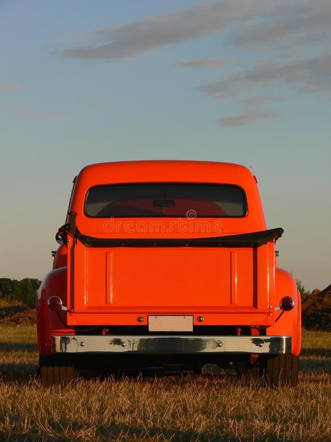 orange hackalastbil upp arkivfoton
