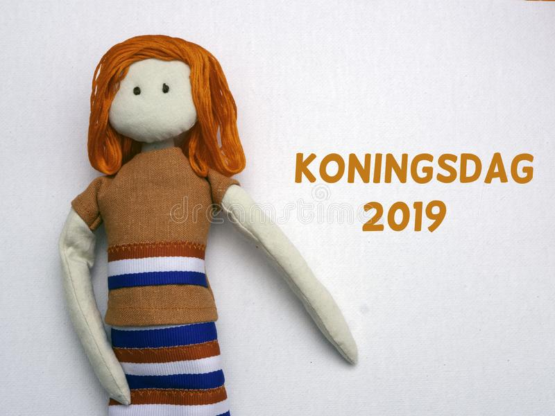 Orange haired rag doll ready for Kings day & x28;Koningsdag in Dutch& x29; stock photos