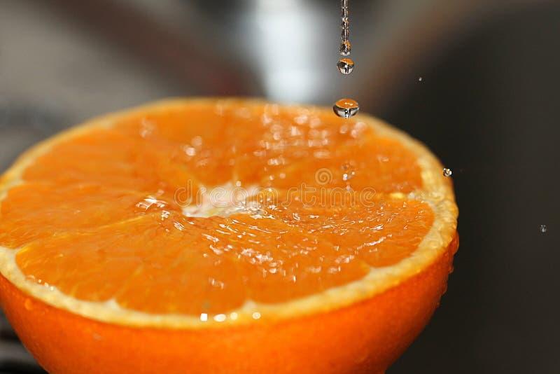 Orange half juicy fresh juice idea refreshing fruit royalty free stock photo