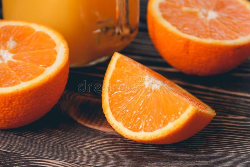 Orange, Half, Lobule. Healthy Lifestyle Concept. Orange, Half of Orange, Orange Lobule on the Wooden Table. Healthy Lifestyle Concept stock image