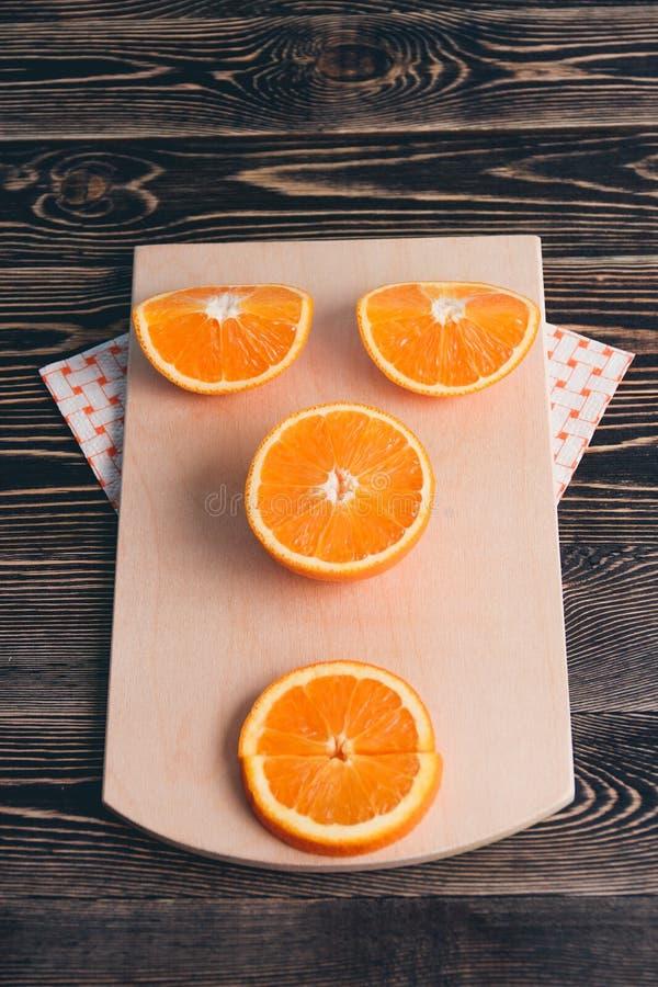 Orange, Half, Lobule. Healthy Lifestyle Concept. Orange, Half of Orange, Orange Lobule on the Wooden Table. Healthy Lifestyle Concept stock photos