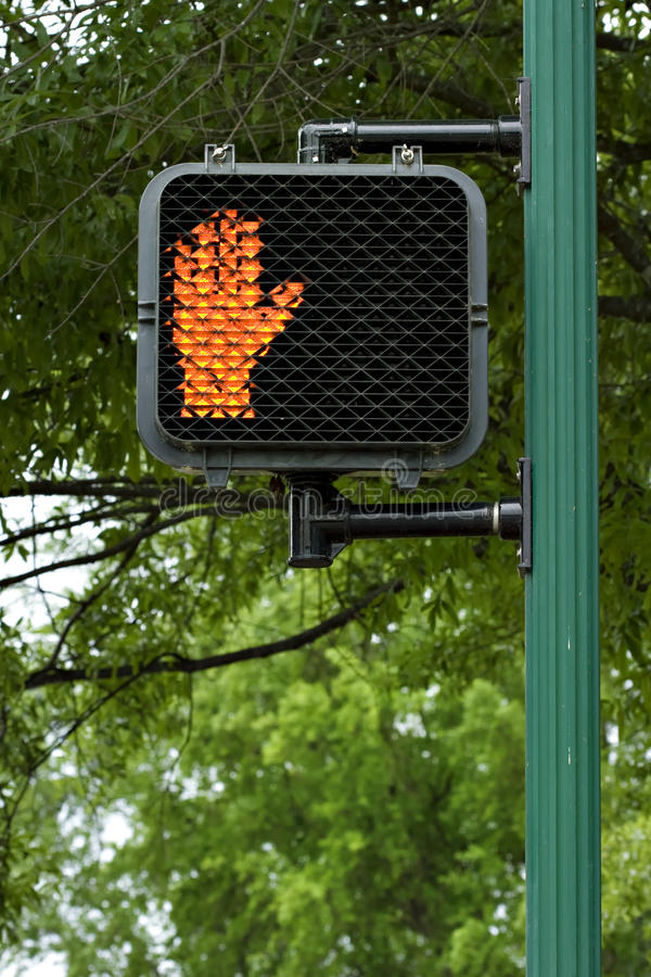 Orange hand don't walk sign. Don't walk sign with orange hand signal on pole royalty free stock images