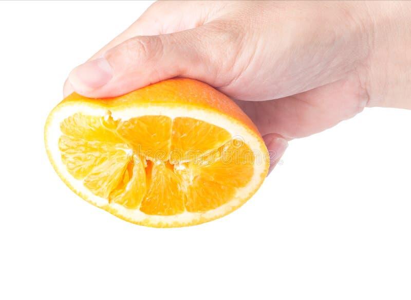 orange in hand royalty free stock image