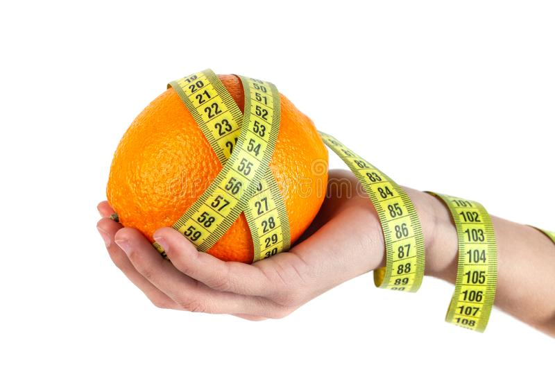 Orange in the hand with measuring tape on white background royalty free stock photos