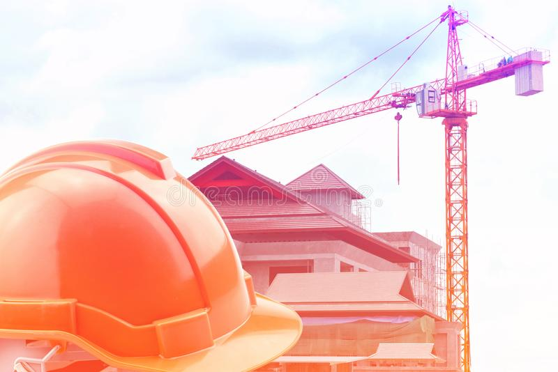 Orange hard hat on construction site stock images