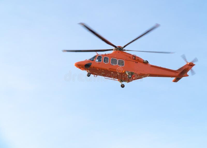 Orange helikopter arkivfoto