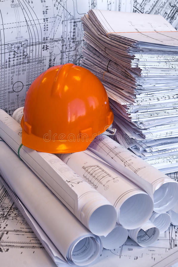 Orange helmet and project drawings stock images