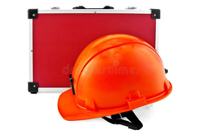 Orange helmet and red suitcase