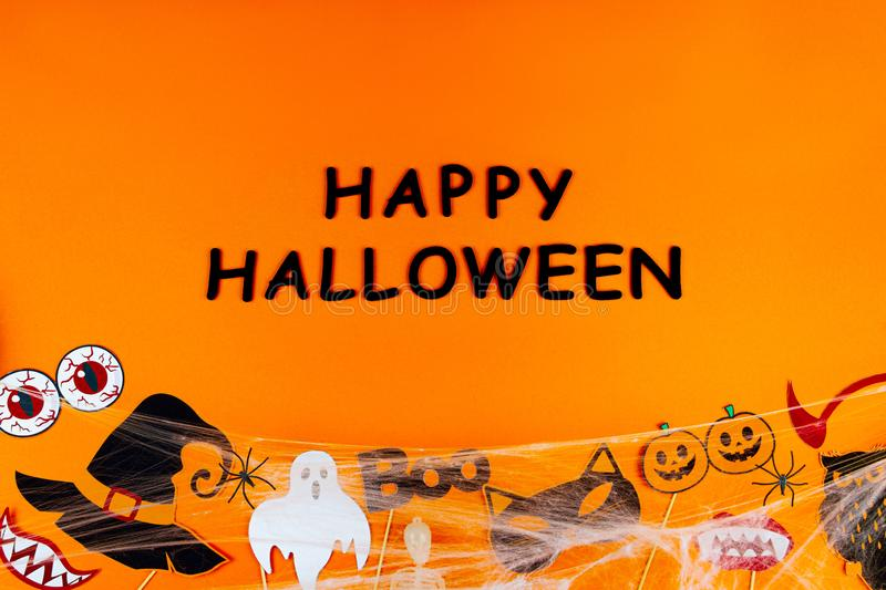 Orange holiday Halloween background with Halloween props stock photo