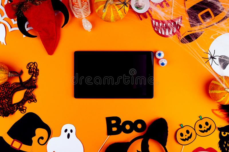 Orange holiday Halloween background with Halloween props stock image