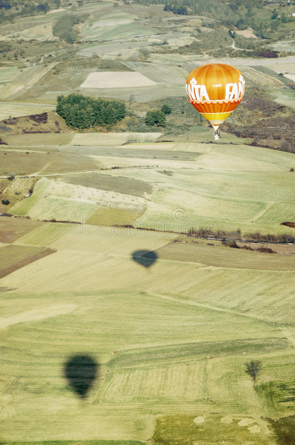 Orange Hot Air Balloon Over Farmed Fields Editorial Stock Image