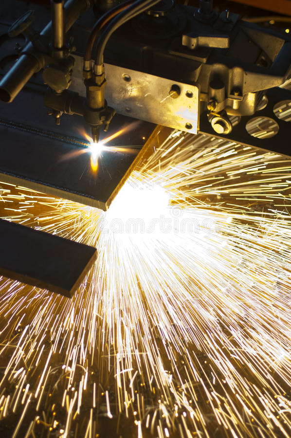 Orange hot sparks. From industry auto cutter plate machine stock image