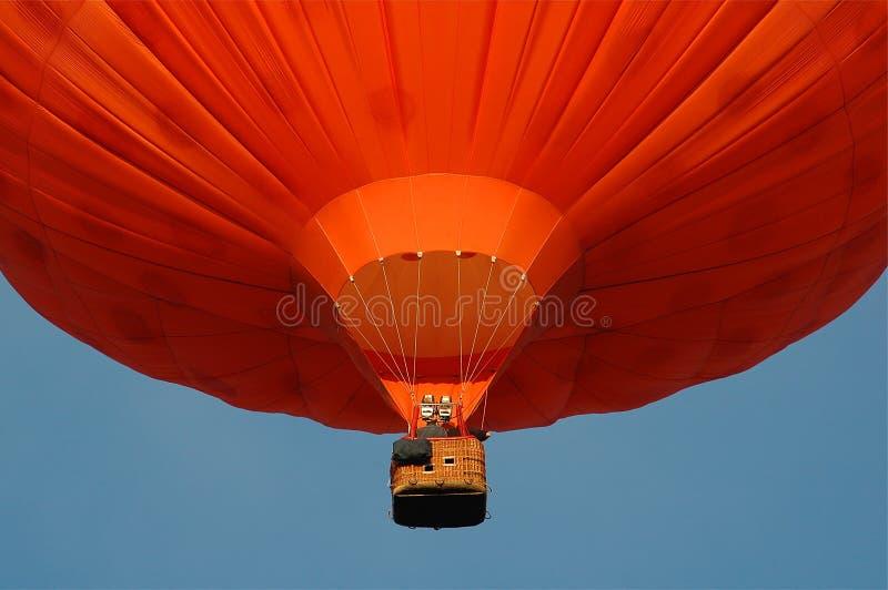 A orange hotair balloon. An orange hotair balloon on a blue background royalty free stock images