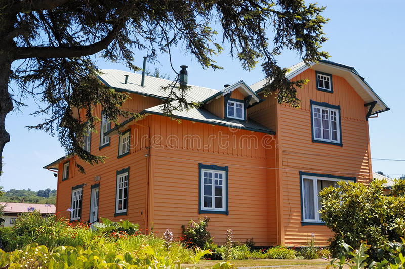 Orange house. Typical construction of the houses built by German settlers in southern Chile during the German colonization royalty free stock photography