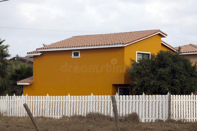 The orange house on the right stock photos