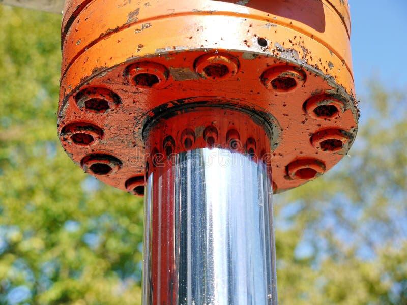 Orange hydraulic cylinder royalty free stock photos