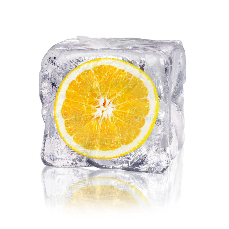 Orange in an ice cube royalty free stock photos