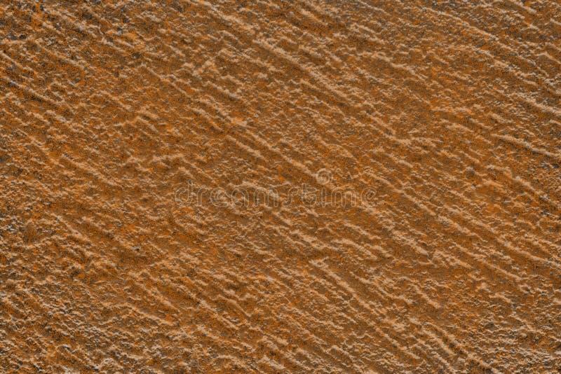 Orange idérik grungemodell av den texturerade stuckaturen som kan användas som texturmodell royaltyfri fotografi
