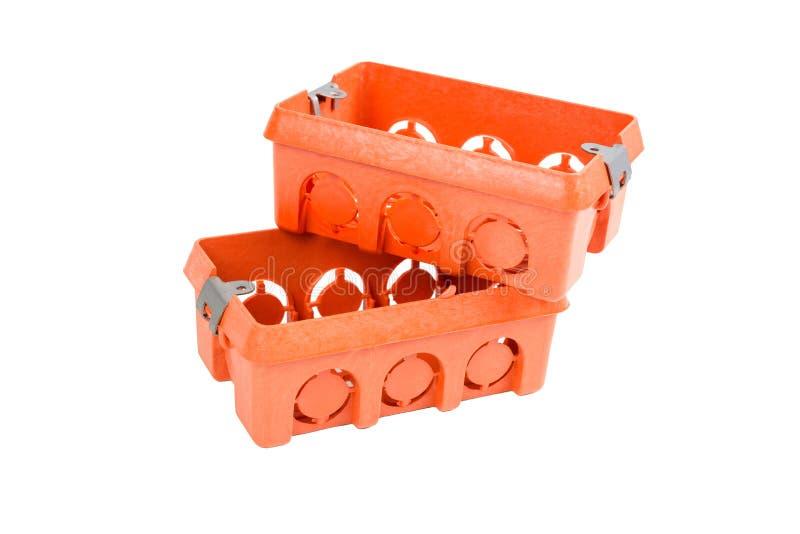 Orange Industry electrical plastic mounting / wall switch / plug sockets rectangle box. Two Orange Industry electrical plastic mounting / wall switch / plug royalty free stock photo