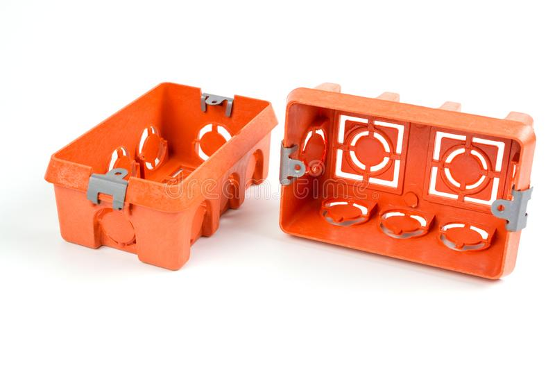 Orange Industry electrical plastic mounting / wall switch / plug sockets rectangle box. Two Orange Industry electrical plastic mounting / wall switch / plug royalty free stock photos