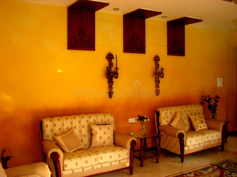 Orange Interiors. A beautiful room with orange shaded walls royalty free stock images