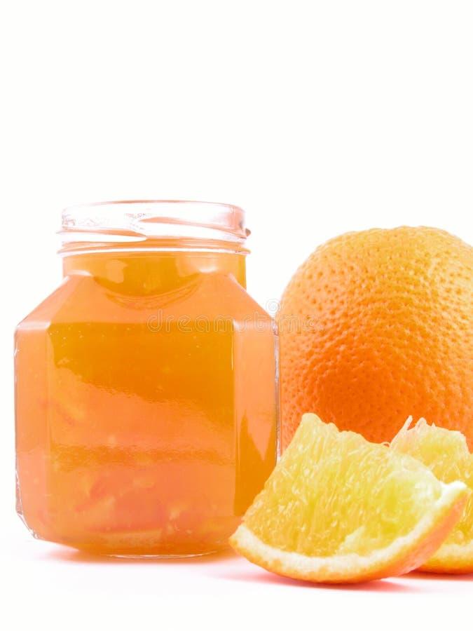 Orange jam. Jar of orange jam isolated on white royalty free stock photos