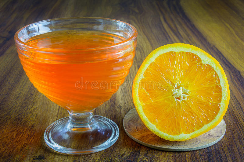 Orange jelly with fruit. royalty free stock images