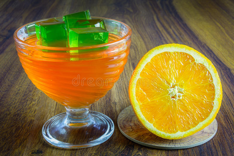 Orange jelly with fruit. stock images