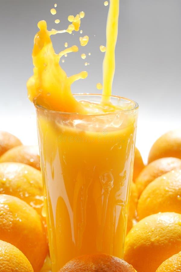 Orange juice. Image of glass of orange juice with fruits near by stock image